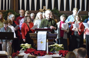 Bob Gregory-Bjorklund leading the choir